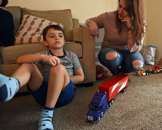 RYAN HUTTON/ Staff photo<br /> Ian Hyso, 5, sits with his mom Redona, right, in their Beverly home on Monday. Ian was left alone on a school bus for more than two hours on Friday and was hurt when he ran into a car trying to get home by himself.