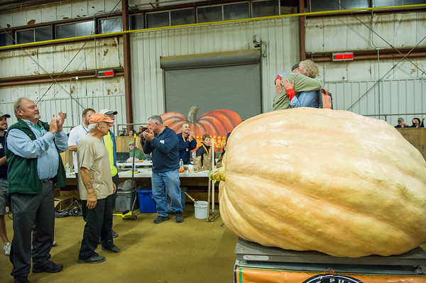 AMANDA SABGA/Staff photo <br /> <br /> Daniel and Holly Boyce of Benson, Vermont hug in celebration as their second place pumpkin weighs in at 2017.5 pounds during the Giant Pumpkin Weigh Off on the first night at Topsfield fair.<br /> <br /> 9/28/18