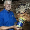 CARL RUSSO/staff photo. SALEM NEWS: Jim Boland, CEO/owner of four local Fuddruckers holds a donation can at the Reading restaurant. Boland shares his story about how he got involved in an annual cure for cancer ride called A Reason to Ride. The ride was founded by a Peabody resident named Tom DesFosses. 9/6/2018