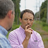 MIKE SPRINGER/Staff photo<br /> Danvers Town Manager Steve Bartha listens to Aaron Henry, the town's director of land use and community services, during a tour Friday of the proposed additions to the Rail Trail in Danvers.<br /> 9/7/2018