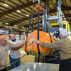 AMANDA SABGA/Staff photo <br /> <br /> From left Ed Jiariusso, Andrew Hughes and Doug Gould guide a pumpkin to the scale during the Giant Pumpkin Weigh Off on the first night at Topsfield fair.<br /> <br /> 9/28/18