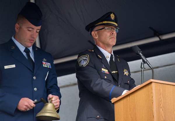 AMANDA SABGA/Staff photo   Captain Shane Ehlers reads the names as Correctional Officer John Cassidy rings the bell during the Essex County Sheriff's Department National POW/MIA Recognition Day Ceremony at the sheriff's department in Middleton.  9/21/18