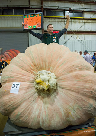 AMANDA SABGA/Staff photo <br /> <br /> Ron Wallace of Greene Rhode Island, poses wth his 2114 pound pumpkin winning the Giant Pumpkin Weigh Off on the first night at Topsfield fair.<br /> <br /> 9/28/18