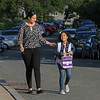 MIKE SPRINGER/Staff photo<br /> Yanela Linares arrives with her daughter Alice Camilo, a second grader, on the first day of school Wednesday at the new Horace Mann Laboratory School in Salem.<br /> 9/5/2018