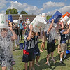 "MIKE SPRINGER/Staff photo<br /> Students at Hamilton-Wenham Regional High School pour buckets of ice water over their heads Wednesday during a mass ""Ice Bucket Challenge"" fundraiser for ALS research. About 150 students and some teachers, administrators, police officers and firefighters took part in the event, which was preceded by a motivational presentation by Nancy Frates, mother of ice bucket challenge originator Pete Yates.<br /> 9/5/2018"