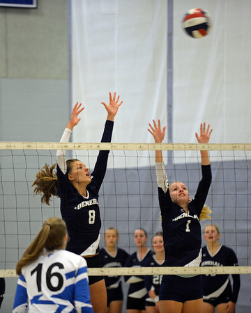 RYAN HUTTON/ Staff photo<br /> Hamilton-Wenham's Gwineth Fitzpatrick, left, and Evelyn Easton, right, leap to try to block a Danvers shot during Monday's volleyball match at Danvers High School.