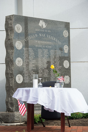 AMANDA SABGA/Staff photo <br /> <br /> Th Missing Man Table stands in front of Vietnam War Veterans memorial during the Essex County Sheriff's Department National POW/MIA Recognition Day Ceremony at the sheriff's department in Middleton.<br /> <br /> 9/21/18