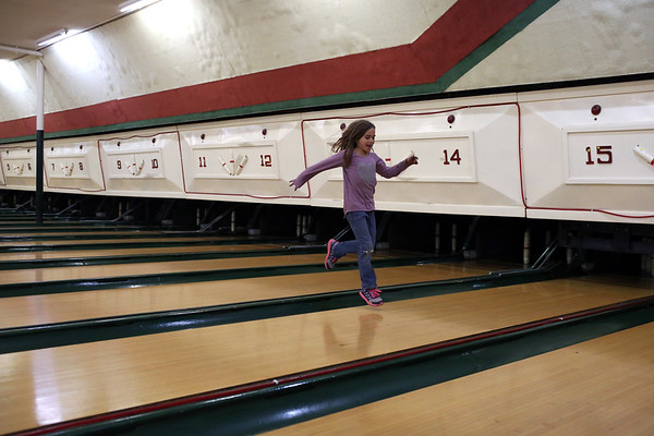 HADLEY GREEN/ Staff photo<br /> Kaitlynn Foote of Gloucester runs through the empty bowling lanes during the liquidation sale at Bowl-O-Mat in Beverly.<br /> <br /> 09/26/2018