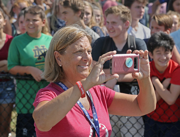 """MIKE SPRINGER/Staff photo<br /> Nancy Frates, whose son Pete is the originator of the """"Ice Bucket Challenge,"""" takes photographs as a group of about 150 students and some teachers, administrators, police officers and firefighters take the challenge Wednesday at Hamilton-Wenham Regional High School in Hamilton.<br /> 9/5/2018"""