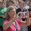 "MIKE SPRINGER/Staff photo<br /> Nancy Frates, whose son Pete is the originator of the ""Ice Bucket Challenge,"" takes photographs as a group of about 150 students and some teachers, administrators, police officers and firefighters take the challenge Wednesday at Hamilton-Wenham Regional High School in Hamilton.<br /> 9/5/2018"