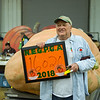 AMANDA SABGA/Staff photo <br /> <br /> Armand Michaud, of Ipswich, poses with his 1602 pound pumpkin that came in fourth place during the Giant Pumpkin Weigh Off on the first night at Topsfield fair.<br /> <br /> 9/28/18