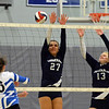 RYAN HUTTON/ Staff photo<br /> Hamilton-Wenham's Deaira Garcia, left, and Rose Wosepka, right, leap to block a Danvers shot during Monday's volleyball match at Danvers High School.