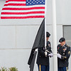 AMANDA SABGA/Staff photo <br /> <br /> Correctional officers Richard Gamble and Heath Coburn raise the flags during the Essex County Sheriff's Department National POW/MIA Recognition Day Ceremony at the sheriff's department in Middleton.<br /> <br /> 9/21/18