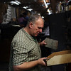 HADLEY GREEN/ Staff photo<br /> Scott Mulcahey of Beverly sorts through old tools behind the bowling lanes at the liquidation sale at Bowl-O-Mat in Beverly.<br /> <br /> 09/26/2018