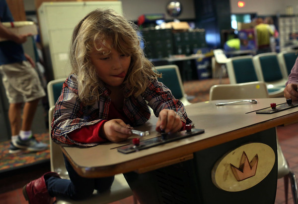 HADLEY GREEN/ Staff photo<br /> Audrey Foote of Gloucester plays with tools she found at the liquidation sale at Bowl-O-Mat in Beverly.<br /> <br /> 09/26/2018