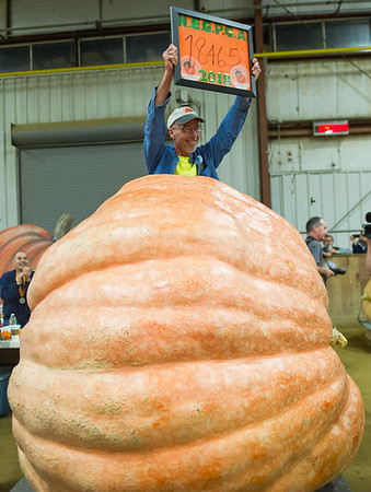 AMANDA SABGA/Staff photo <br /> <br /> Scott Marley of Bellingham celebrates his third place pumpkin that weighed 1846.5 pounds during the Giant Pumpkin Weigh Off on the first night at Topsfield fair.<br /> <br /> 9/28/18