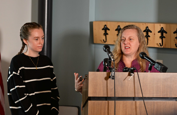 RYAN HUTTON/ Staff photo<br /> Student pilot Maggie Taraska, 17, left, listens as her mom Christine, right, speaks about  talking with her daughter after Maggie made a successful emergency landing on Sunday when one of her plane's wheels fell off during takeoff.