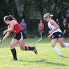HADLEY GREEN/ Staff photo<br /> Amesbury's Twombly (18) runs down the field while Hamilton-Wenham's Sarah Cooke (14) plays defense at the Hamilton-Wenham v. Amesbury field hockey game in Hamilton.<br /> <br /> 09/24/2018