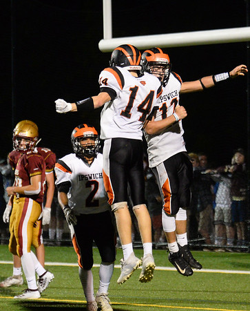 CARL RUSSO/staff photo. Ipswich's Justin Bruhm, left and quarterback Cam James celebrate the team's first touchdown of the game. Newburyport high vs. Ipswich high in Friday night football action. 9/20/2019