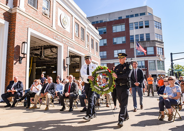 Fire Chief Alan Dionne and Police Chief Lucas Miller both carry a wreath to place on a 9/11 memorial site while being escorted by Salem Mayor Kim Driscoll and Congressman Seth Moulton during a ceremony at the Salem Fire Department in Salem in observance of the 20th anniversary of the World Trade Center terror attacks in New York City on September 11, 2001.<br /> <br /> JAIME CAMPOS/Staff photo 9/11/2021