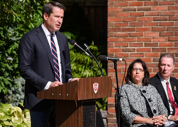 Congressman Seth Moulton delivers a speech as Salem Mayor Kim Driscoll and Representative Paul Tucker look on during a ceremony at the Salem Fire Department in Salem in observance of the 20th anniversary of the World Trade Center terror attacks in New York City on September 11, 2001.<br /> <br /> JAIME CAMPOS/Staff photo 9/10/2021