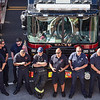 Firefighters line-up in front of firetrucks during a ceremony at the Salem Fire Department in Salem in observance of the 20th anniversary of the World Trade Center terror attacks in New York City on September 11, 2001.<br /> <br /> JAIME CAMPOS/Staff photo 9/10/2021