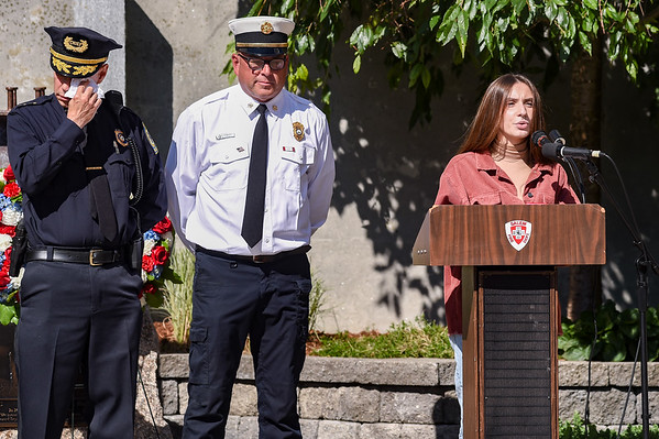 Salem High School student Aimena Puayu recites a poem as Police Chief Lucas Miller, left, wipes away tears during a ceremony at the Salem Fire Department in Salem in observance of the 20th anniversary of the World Trade Center terror attacks in New York City on September 11, 2001.<br /> <br /> JAIME CAMPOS/Staff photo 9/10/2021