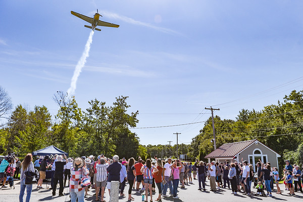A plane flies over the site as part of the program during a ceremony in association with Historic Beverly at the Massachusetts Task Force 1 FEMA Urban Search & Rescue headquarters in Beverly in observance of the 20th anniversary of the World Trade Center terror attacks in New York City on September 11, 2001.<br /> <br /> JAIME CAMPOS/Staff photo 9/11/2021