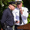 Police Chief Lucas and Fire Chief Alan Dionne do a joint radio transmission through their respective departments during a ceremony at the Salem Fire Department in Salem in observance of the 20th anniversary of the World Trade Center terror attacks in New York City on September 11, 2001.<br /> <br /> JAIME CAMPOS/Staff photo 9/10/2021