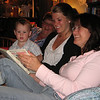 Adrian reads a book with Mom, Chelsea and Karen