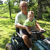 Great Grampy and Adrian go for a tractor ride.