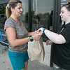 """The Salvation Army held a """"Stuff the Bus"""" event at the Lunenburg and Leominster Walmart's on August 3, 2019. The event was to collect  school supplies for students to help them start off the school year with what they need. Tricia Kanan of Townsend hands over some supplies she had just bought to Megan Meany the Salvation Army's Bridging the Gap class aid. SENTINEL & ENTERPRISE/JOHN LOVE"""