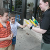 """The Salvation Army held a """"Stuff the Bus"""" event at the Lunenburg and Leominster Walmart's on August 3, 2019. The event was to collect  school supplies for students to help them start off the school year with what they need. Callum Hoos, 7, and his brother Jasper, 5, of Ayer hand over some supplies, they had just bought, to Megan Meany the Salvation Army's Bridging the Gap class aid. SENTINEL & ENTERPRISE/JOHN LOVE"""