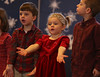 HOLLY PELCZYNSKI - BENNINGTON BANNER Preschooler Kairi Favreau sings with her classmates on dressed in festive red clothes during the annual Christmas concert at The School of Sacred Heart St. Francis de Sales on Friday in Bennington.