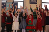 HOLLY PELCZYNSKI - BENNINGTON BANNER First graders dance and sing wearing festive clothes for the holiday season during their annual Chirstmas celebration at The School of Sacred Heart St. Francis de Sales on Friday afternoon in Bennington.