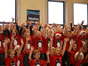 HOLLY PELCZYNSKI - BENNINGTON BANNER Students at The School of Sacred Heart St. Francis de Sales raise their hands in celebration during their Annual Christmas Concert held at the school on Thursday afternoon in Bennington.