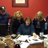 State Rep. Colleen Gary shows search volunteers a map at her office at 22 Boradway road.