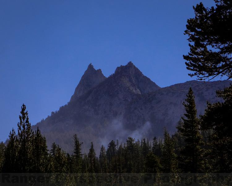 Smoke rising before Cathedral Peak
