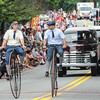 John Strickler - Digital First Media<br /> David Garrety and Noah White pedal their high wheeler bicycle during the Skippack 4th of July parade.