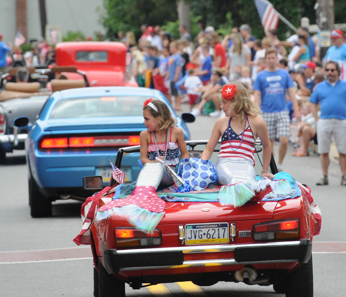 John Strickler - Digital First Media<br /> OWners of classic vehicles drive the parade route in Skippack on the 4th of July.