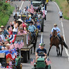 John Strickler - Digital First Media<br /> A line of tractors pulling wagons filled with parade passengers move along slowly in the Skippack 4th of July parade.