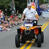 John Strickler - Digital First Media<br /> Ronald Sharks a veteran and career serviceman in the U.S. Navy rise his 4-wheeler in the Skippack 4th of July parade.