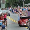 John Strickler - Digital First Media<br /> People riding toss candy to children watching the Skippack 4th of July parade.