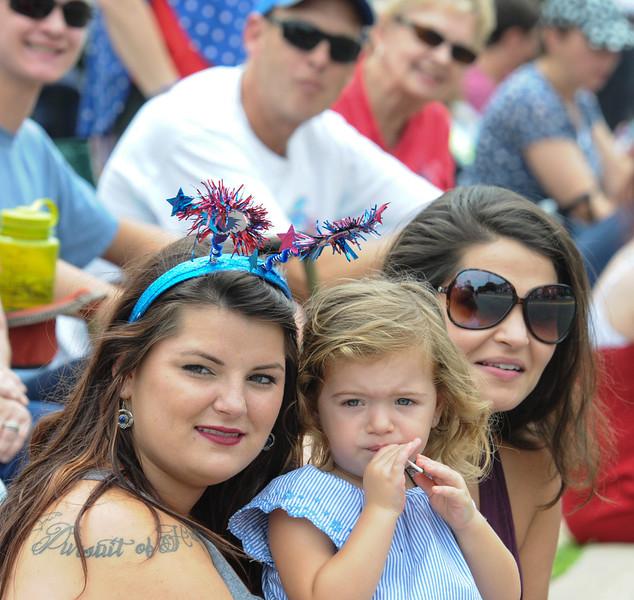 John Strickler - Digital First Media<br />  Gabriella Gallo along with Sophia Seminaro and her daughter Valentina Seninaro watch the Skippack 4th of July parade.