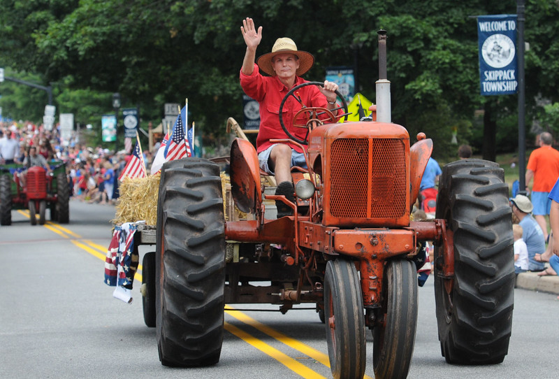 John Strickler - Digital First Media<br /> Garrett Burch waves to the crowd watching the Skippack 4th of July parade.