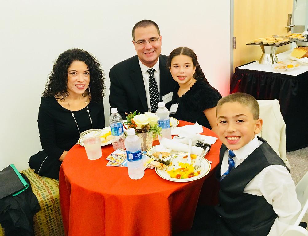 . Maria and John Porto Jr., with children Olivia and Lucas, all of Pelham