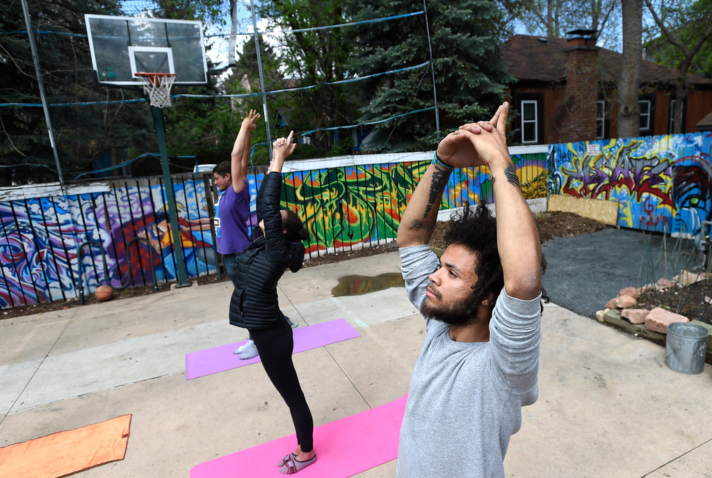 . Amiel Foster, 23, at right, Maia Whiteman, 18, and Brandon George, 22, all of whom are homeless, participate in a yoga session at The Source on Thursday in Boulder. For more photos of activity at The Source go to www.dailycamera.com Jeremy Papasso/ Staff Photographer/ May 11, 2017