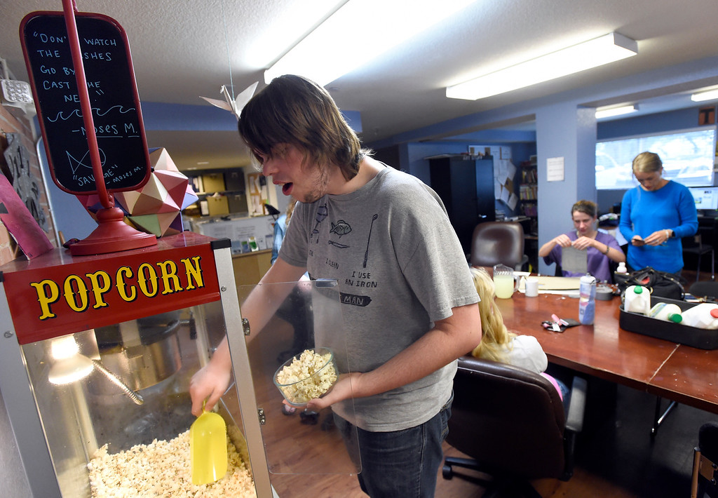 . Thomas Rogers, 18, grabs a bowl of popcorn while hanging out at The Source on Thursday in Boulder. Rogers is homeless. For more photos of activity at The Source go to www.dailycamera.com Jeremy Papasso/ Staff Photographer/ May 11, 2017
