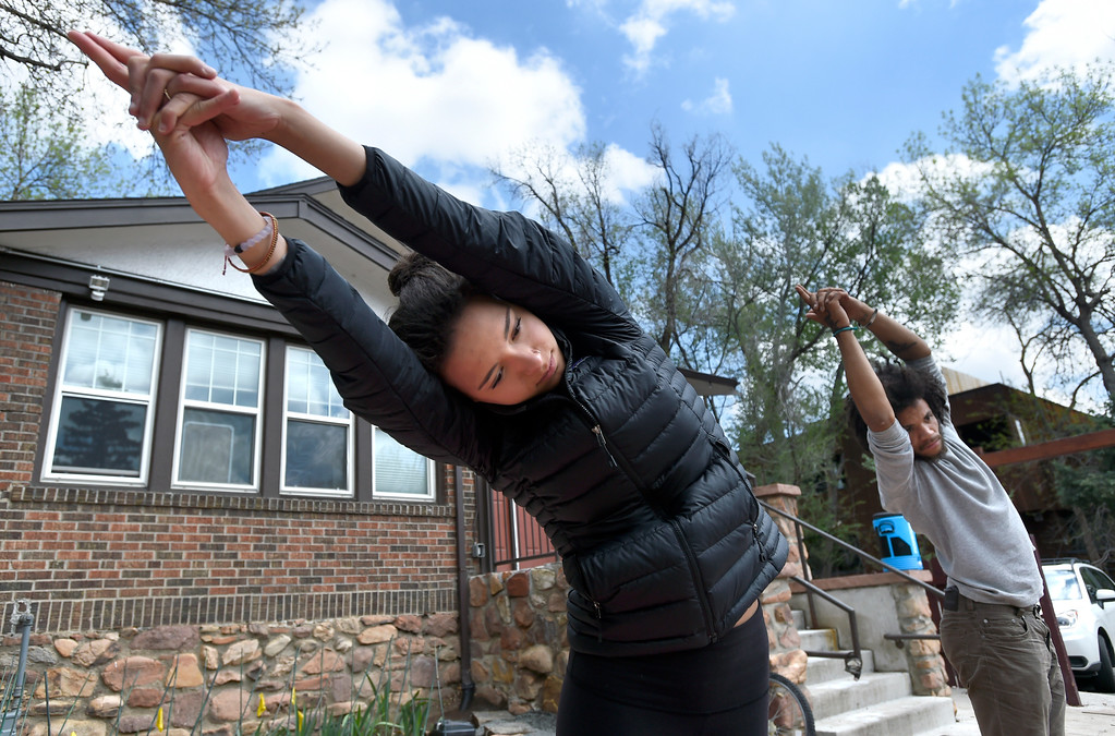 . Maia Whiteman, 18, left, and Amiel Foster, 23, both homeless, participate in a yoga session at The Source on Thursday in Boulder. For more photos of activity at The Source go to www.dailycamera.com Jeremy Papasso/ Staff Photographer/ May 11, 2017