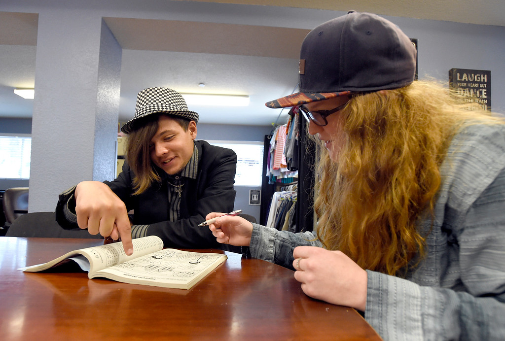 . Drop-in coordinator Kerri Scharfenberg, at right, works with Sean Michael, 22, at The Source on Thursday in Boulder. Michael is homeless. For more photos of activity at The Source go to www.dailycamera.com Jeremy Papasso/ Staff Photographer/ May 11, 2017